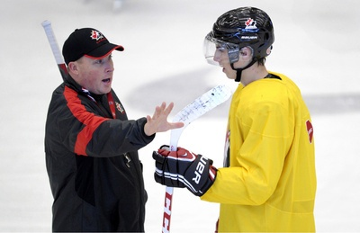 Head coach Steve Spott talks to Ryan Nugent-Hopkins during a recent practice for Canada's national junior team.