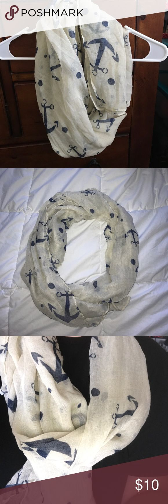 Cream and blue anchor scarf This tan/creamy anchor scarf has polka dots and can be worn many different ways!! It is NOT an infinity scarf.  This is new and only worn once.  I originally bought it just because I went through an anchor phase and wanted it but never wore it! It is in perfect condition! Accessories Scarves & Wraps