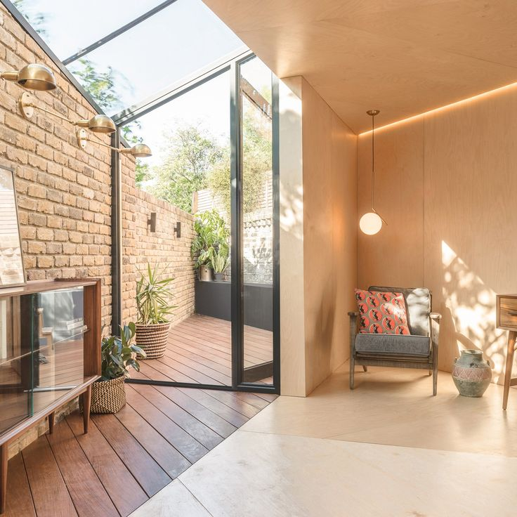 Hackney-based Yellow Cloud Studio has designed a triangular glass and plywood extension for a Victorian house in east London that makes a virtue of its awkward space.