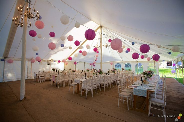 When using pink and purple wedding lanterns mix the sizes and tones to create a fun atmosphere on your big day.