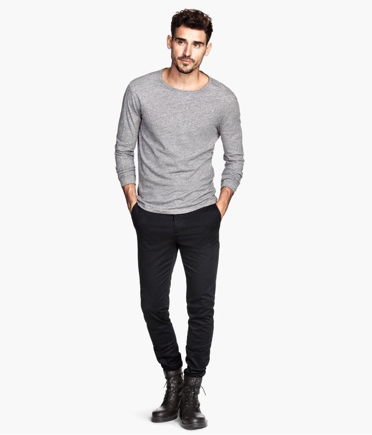 Grey shirt, tight black pants and boot