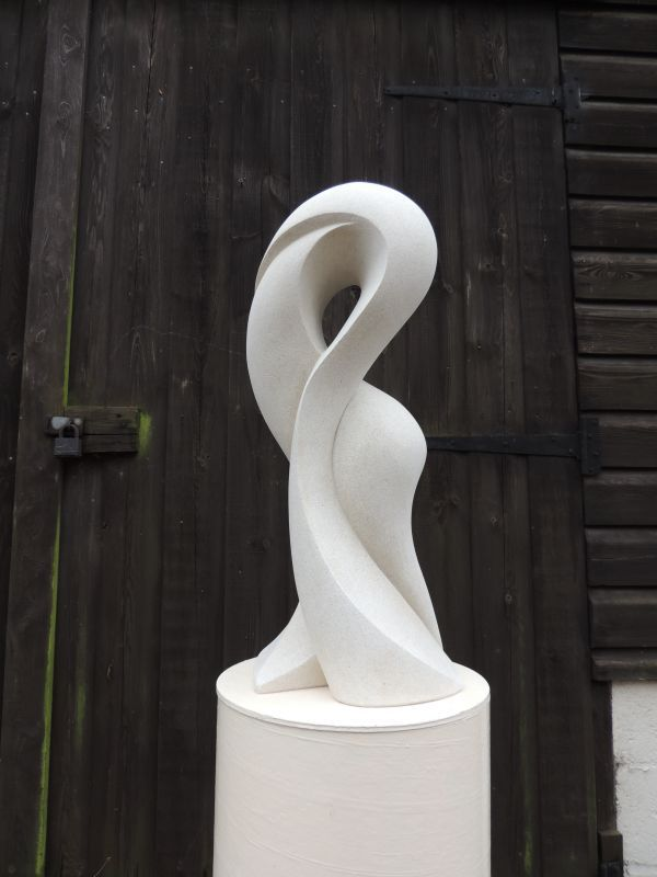 Hand made marble/mineral stone Abstract Contemporary or Modern Outdoor Outside Exterior Garden / Yard Sculptures Statues statuary sculpture by artist Jo Ansell titled: 'Morphe (abstract StylisedFlowing Form Carved Contemporary stone statue)'
