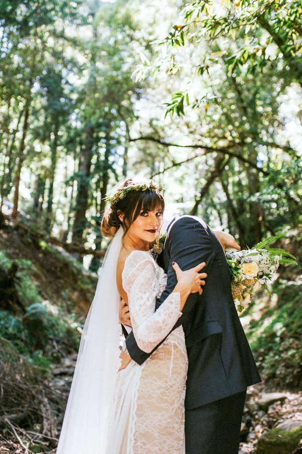 The bold bangs, the lace dress, the dark lip, the floral crown - love this fall bridal style | Image by Seth & Kaiti Photography