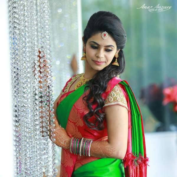 South Indian bride. Gold Indian bridal jewelry.Temple jewelry. Jhumkis Green and red silk kanchipuram sari.Half updo with fresh flowers. Tamil bride. Telugu bride. Kannada bride. Hindu bride. Malayalee bride.Kerala bride.South Indian wedding.