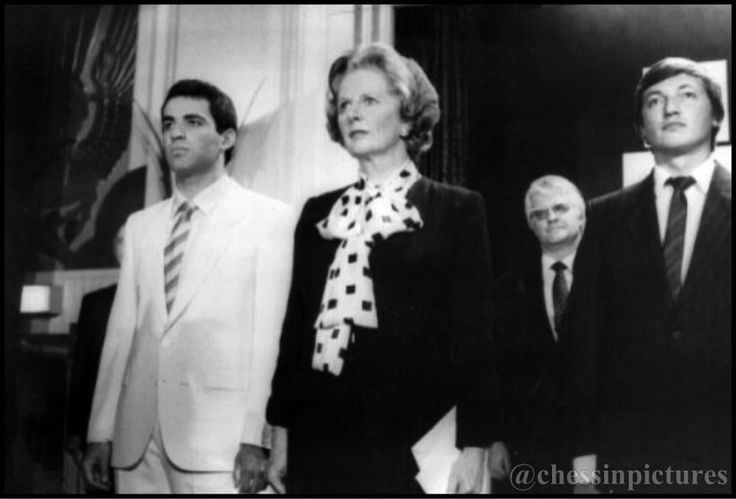 Russian chess players Garry Kasparov (left) and Anatoly Karpov (right) with British prime-minister Margaret Thatcher. Referee Lothar Schmid at the background. London, 1986.