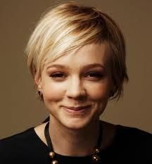 Carey Mulligan; short & soft straight blonde pixie cut. Hairstyle: Short Straight Medium length pixie cut.  Hair Color: Heavy Blonde Weave/Highlights  Bangs: Piece-y to the side bangs. Carey's hair is razor-ed and textured to give it that sharp style. Her bangs make this style so perfect ! The back of her hair is left shorter and her bangs are long/razor-ed and piece-y.