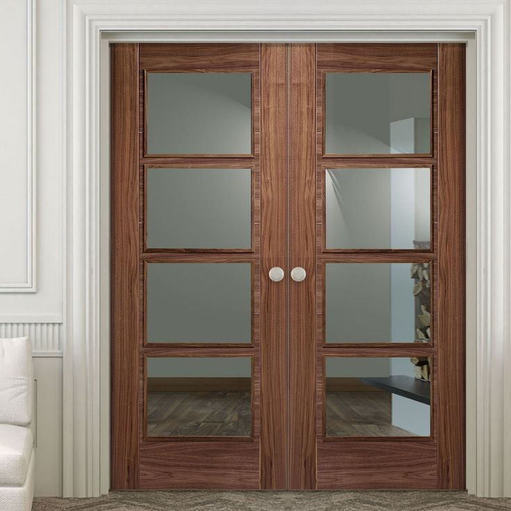 Vancouver Walnut 4L Fire Door Pair with Clear Glass is 30 Minute Fire Rated and Pre-finished. #glazedwalnutfoldingdoors #internaldoublefiredoor #glazedwalnutfiredoors