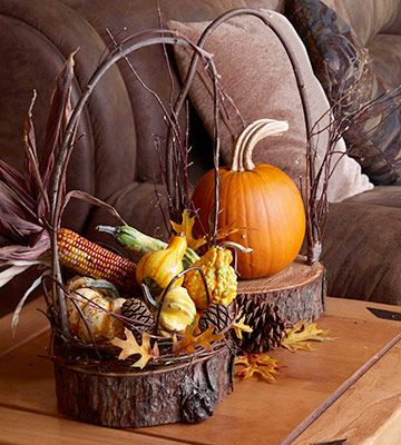 Rustic baskets built from natural finds look beautiful on a living room table. Filling them with fall's bounty helps extend the warmth of Thanksgiving to your decor./