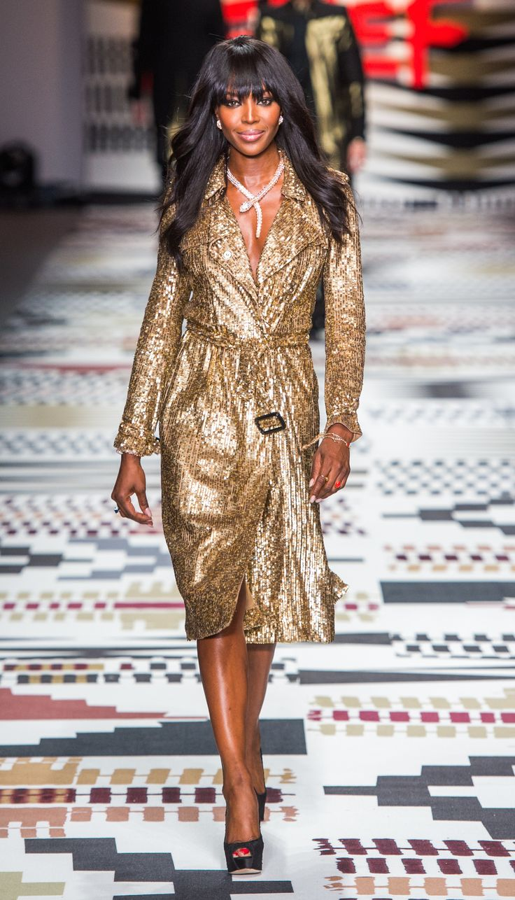 Campaign star Naomi Campbell wearing a Burberry sequin trench coat on the Fashion 4 Relief runway in London