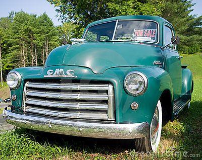 A green vintage General Motors Corp pickup truck.