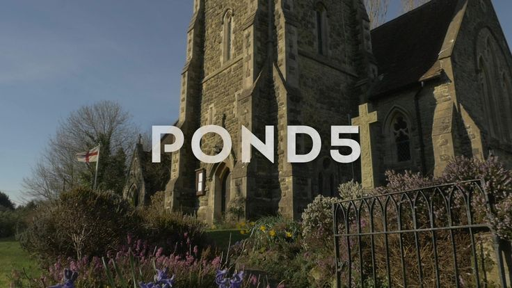 Low Angle Church Garden Clock Tower Stone Cross St George's Flag Slow Motion - Stock Footage | by RyanJonesFilms