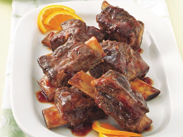 Beef short ribs come out of the slow cooker tender and flavorful. Plum preserves add a sweet twist to the barbecue sauce.
