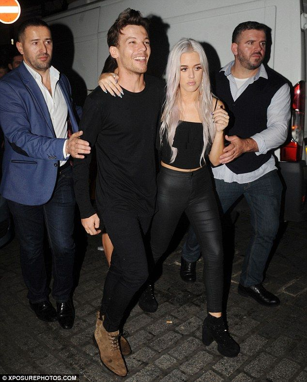 Helping hand: Louis Tomlinsonwas joined by younger sister Lottie as they made an exit fro...