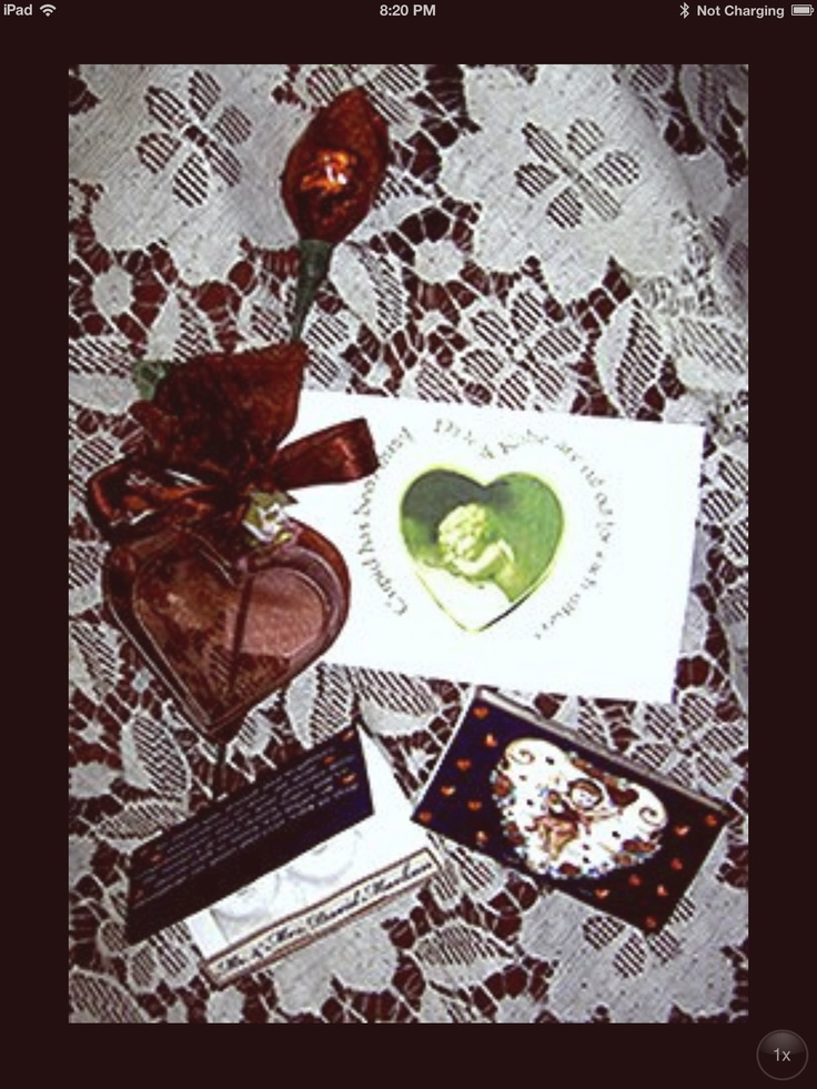 Gifts for each guest at their place-setting. Candy flower attached with double heart cookie cutters  in an organza bag and a laminated heart card with a recipe on the back and mint matchbook. (Showing the front and back)…                                                                                          By: Voila PanacheHeart Cookies, Cookies Cutters, Cookie Cutters