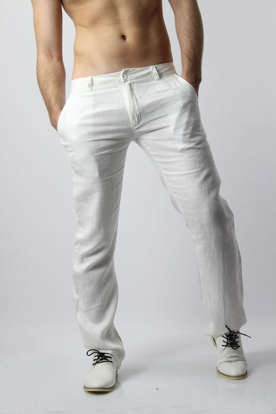 Mens white linen trousers pants, perfect for summer weddings beach events. Mens white linen trousers, men loose fit. Shop mens white linen trousers here