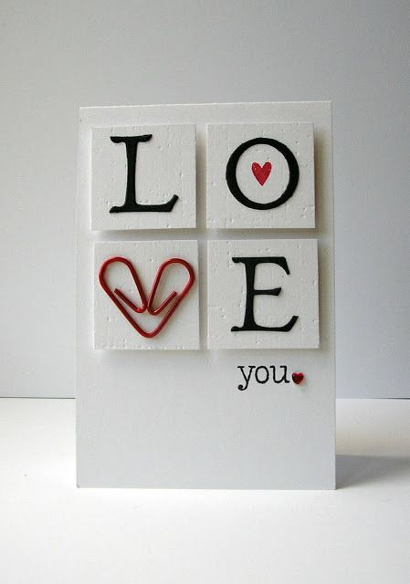 """handmade LOVE card ... die cut letters and a bent red paper clip spell out """"love"""" on blocks ... clean graphic look ..."""