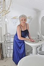 Navy Satin Night Dress - This is a customer favourite, the Navy Satin Night Dress is an elegant long classic night dress made from Italian stretch satin. Its body skimming shape has a lovely curve around the bottom of the garment, with a side slits to the knee. The frill has two colours of embroidery and is flattering and softens the bust area.