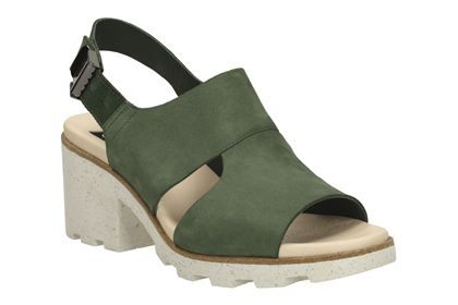 In collaboration with British fashion designer Christopher Raeburn and based on his jungle exploration theme, we've designed a slingback mule with cut out detail. Combining dark green nubuck with a contrasting speckled, cleated EVA sole for a lightweight yet modern feel. A chunky 6.5cm heel adds wearable height while a flip down adjustable buckle with Raeburns' seasonal motif finishes the look.