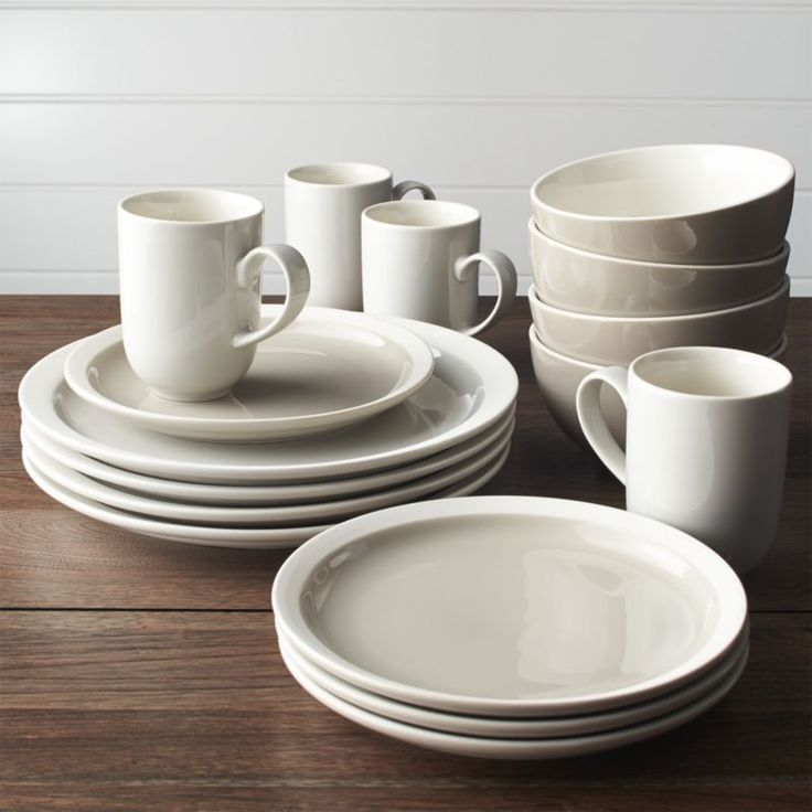 Shop Graeden 16-Piece Dinnerware Set.  Glossy neutrals and unglazed rims add sophisticated contrast to clean porcelain shapes for modern everyday dining.