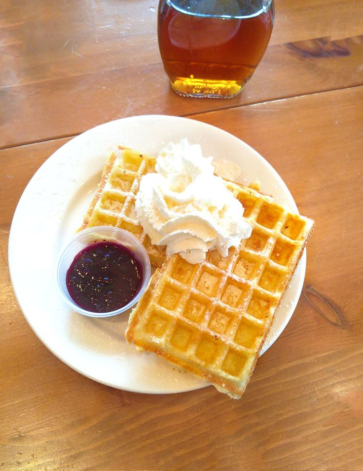 Belgian Waffles: Traditional waffles topped with maple whipped cream and served with blueberry preserves.  Venue: www.templessugarbush.ca Photo Credit: http://www.stephaniewhite.style/bring-on-the-maple-at-temples-sugar-bush/