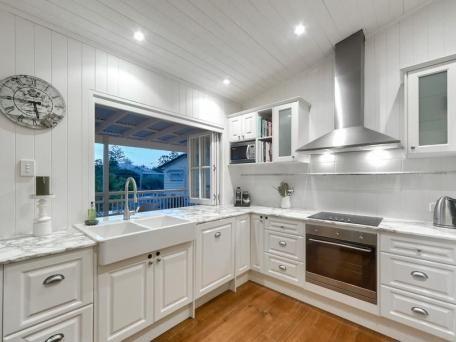 Kitchen bifold servery window and modern white cottage style kitchen
