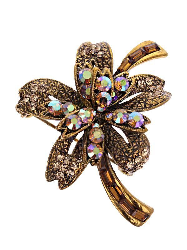 Brosa martisor in forma de floare de culoare aurie cu pietre multifatetate aurii si cu reflexii multicolore. Raspunde celor mai exigente gusturi!