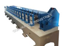 De coiler 1 ton cap.     Entry Gate with     Roll Forming Line with 9 station , 1 Gear Boxes & 2 H.P. electrical.     Control Panel semi auto     Cutting Unit
