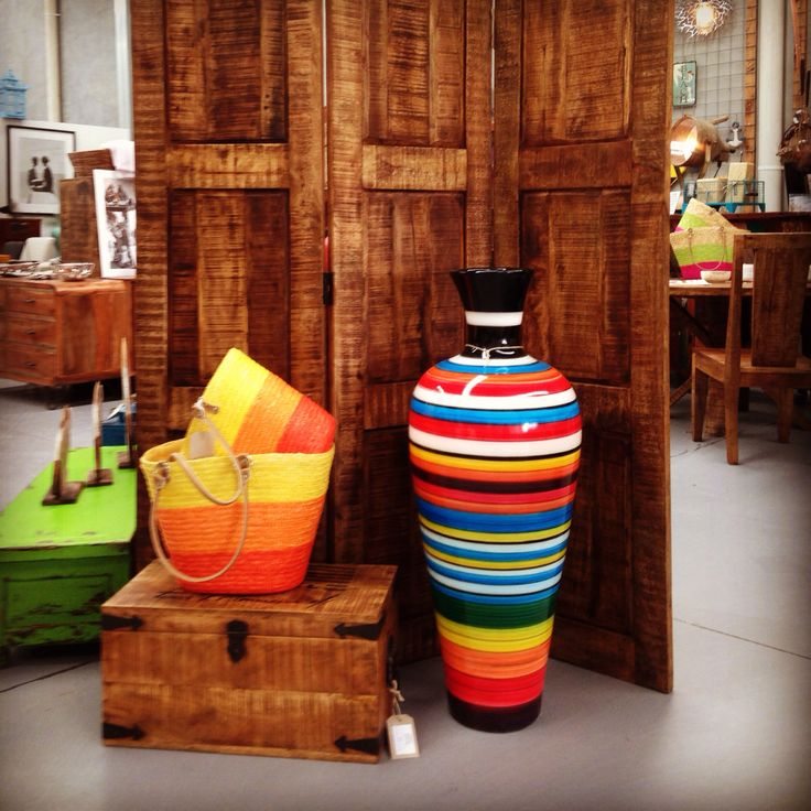 Beautiful ceramics and textiles in front of a mango screen divider