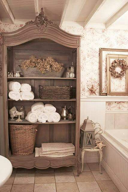 An old hutch turned into a linen cabinet.
