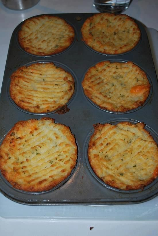 "Mashed potatoes, mixed with butter and bacon, chives, spices, cheese. Stuff into a greased muffin tin and ""fork"" down the tops. Brush on melted butter or olive oil and bake at 375F until the tops are crispy and golden brown."
