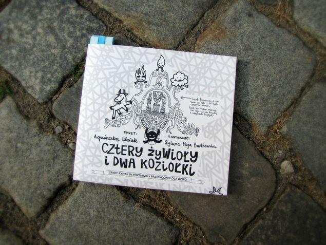 Cztery żywioły i dwa koziołki Stary Rynek w Poznaniu. Przewodnik dla dzieci Wydawnictwo Albus, Pikinini