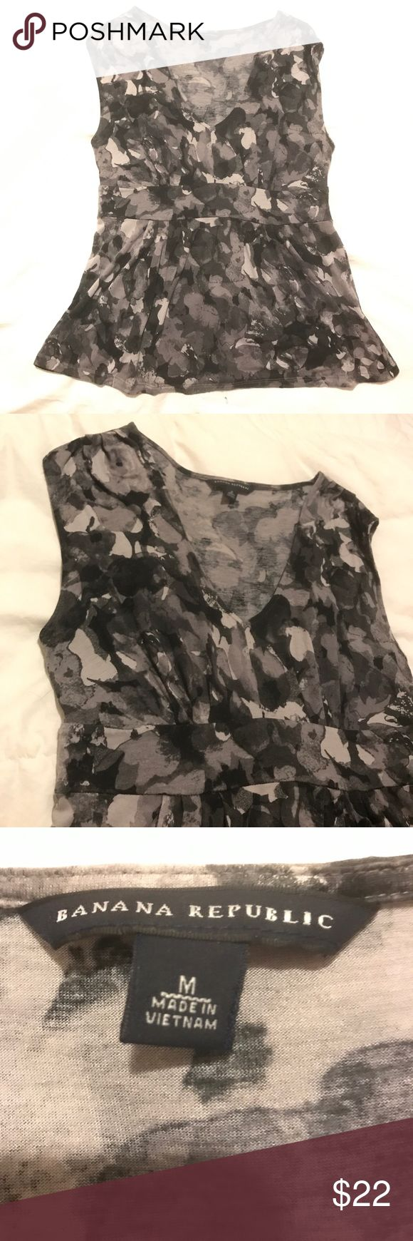 Sleeveless Top This is a grey sleeveless top perfect for work and to dress up with accessories for a night out at a restaurant. It is made up of 70% Rayon and 30% Lyocell. Banana Republic Tops Blouses