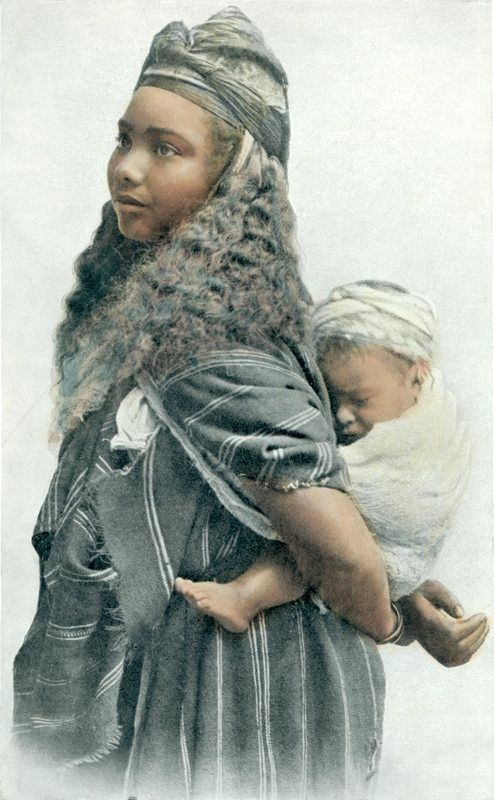 Africa | A young Moorish woman with child. Algeria. ca. early 1900s