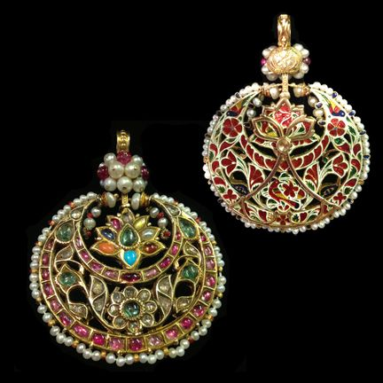 A Navaratna Pendant | India Jaipur | 18/19th Century | A crescent moon pendant inlaid with rubies diamonds and emeralds in the kundan style with a flower within the crescent which has the nine holy stones (navaratna) unusually revolving around an emerald. The reverse has fine Jaipur enamel of flowers and birds in red, green and blue enamel on a white ground.