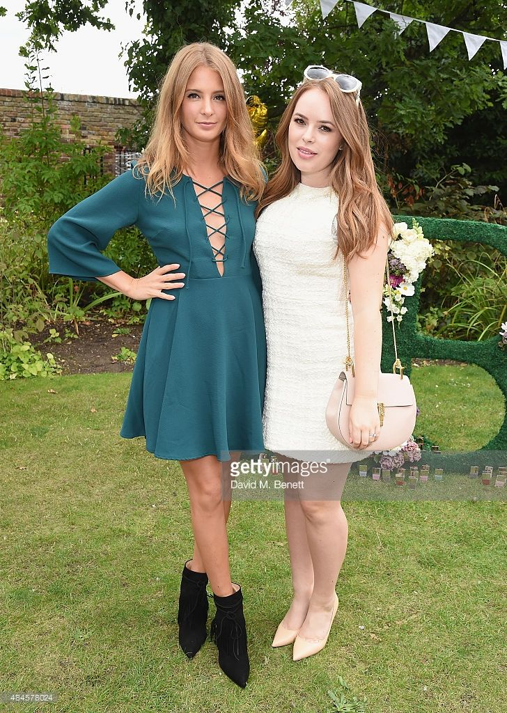 Millie Mackintosh and Tanya Burr attend Tanya Burr's Cosmetics New Beauty Collection Launch Party at Kensington Roof Gardens on August 20, 2015 in London, England.
