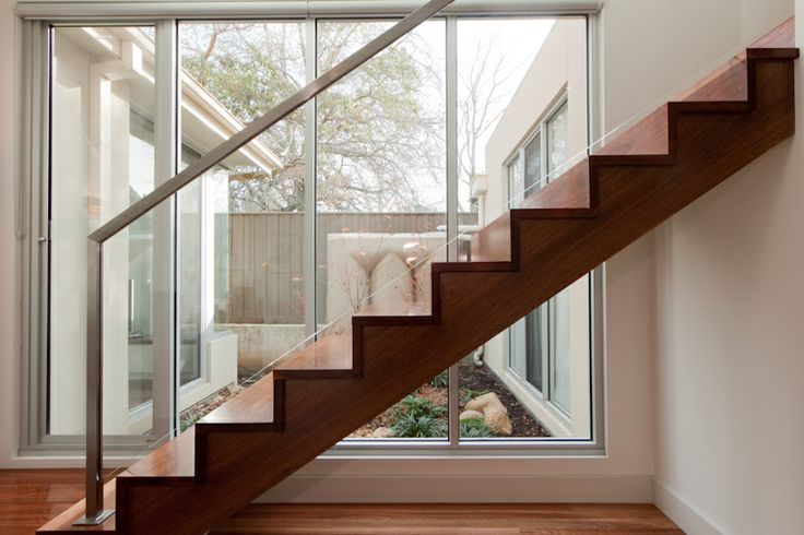Spotted Gum | Timber | Modern | Closed Stair | Cut Strings | Stained | Stainless Steel Handrail | Glass Balustrade | Butted Treads & Risers