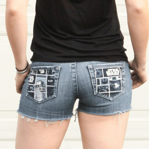 """These Star Wars shorts were made from a pre loved pair of jeans. There is Star Wars fabric covering the back pockets of the shorts. The shorts on the model have a 30"""" waist, 7.5"""" rise and a 35"""" hips."""