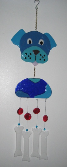 Give a Dog a Bone - Glass Wind Chime  With a knick-knack patty-whack, give a dog a bone, this dog and bones glass wind chime is both clever and eye catching.