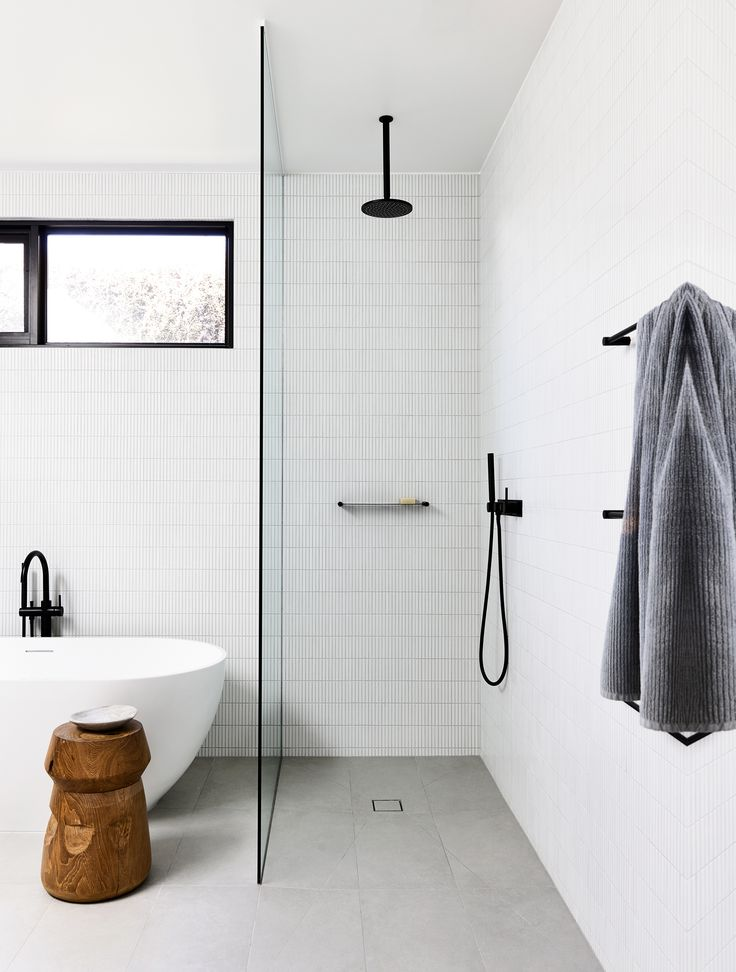 Clean lines and an expert blend of tiling and textures create interest in this black-and-white bathroom in a Mornington Peninsula Home by Planned Living Architects. Photography: Derek Swalwell | Styling: Natalie James | Story: Belle