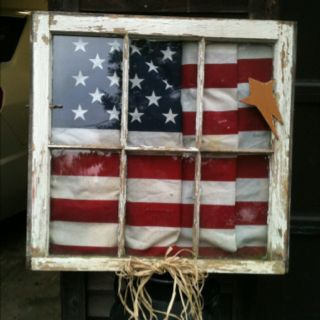 Old window frame with American Flag in back