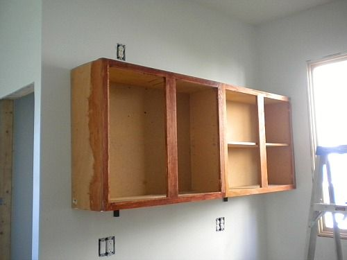 Kitchen cabinets: installed. | Hanging cabinet, Installing ...