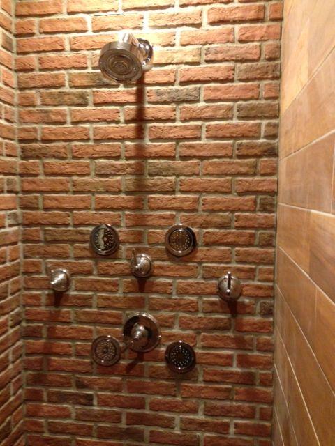 A bathroom shower wall, Lancaster Running Bond brick tiles, Marietta color mix.