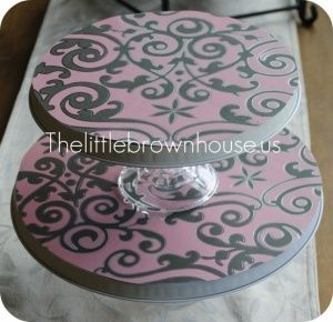 Dollar store stove burners + scrapbook paper + glass candle holders + spray paint = CUTE cupcake stand!