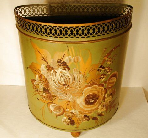 Vintage Tole ware Toleware Trash Can Green Metal Color With Victorian Flowers W/wood feet Mid Century. $18.00, via Etsy.