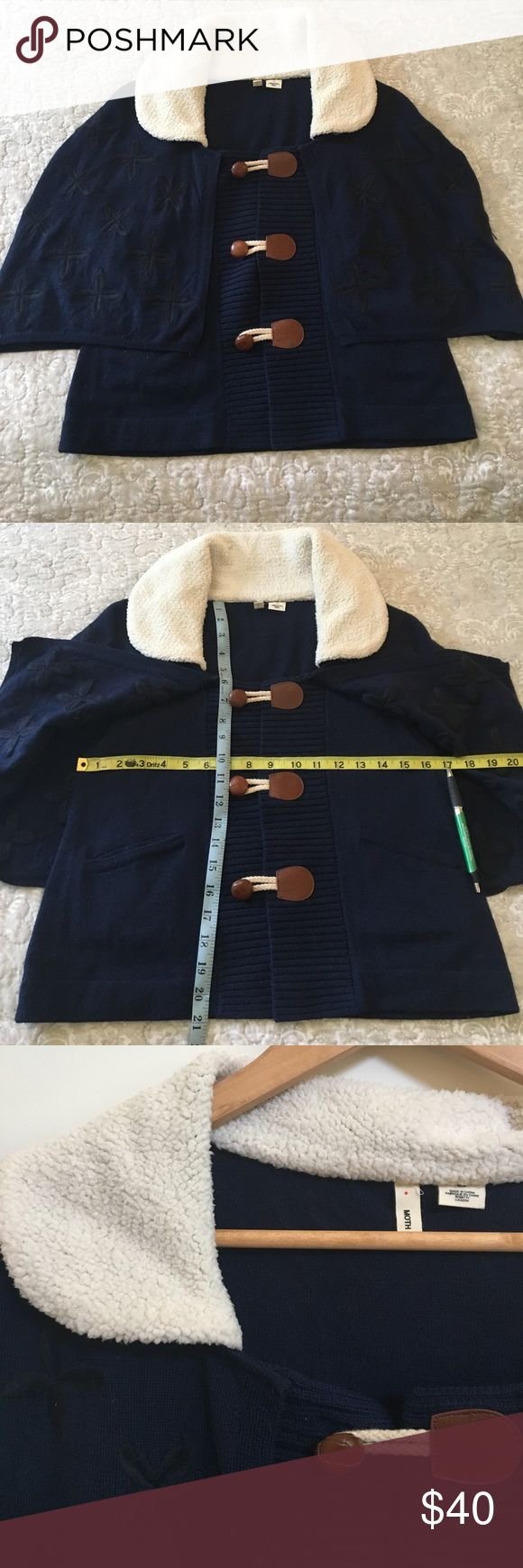 Anthropologie Moth Navy Sweater Cape Anthropologie Moth Navy Sweater Cape. Removable black flower embroidered cape. Removable wool collar. Three button closure. Two front pockets. Last pic show small holes. Can be easily sewn up and unnoticeable. Anthropologie Sweaters Shrugs & Ponchos