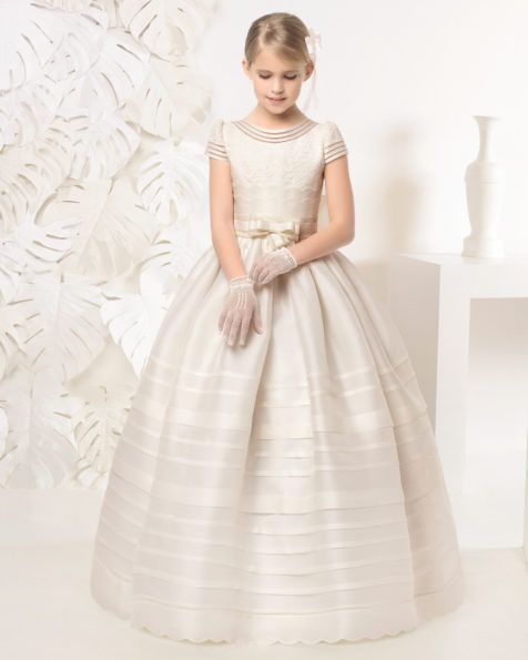 First Communion dress with basketweave pin tucks. Available in white and ivory.