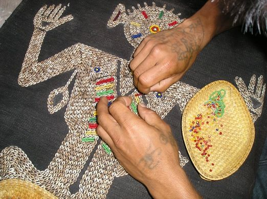 Beautification: Beads and shells are sewn onto a textile from Sumba. (Photo courtesy of Threads of Life)