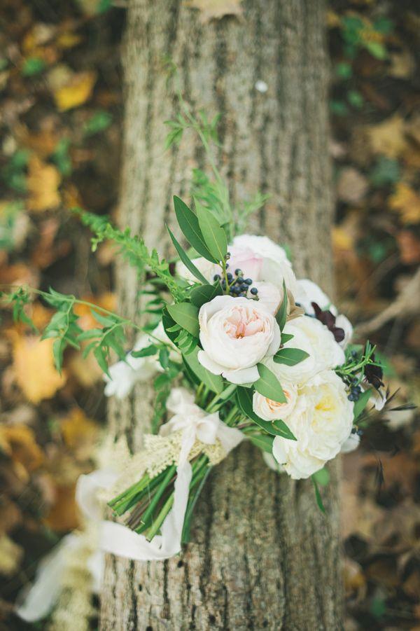 garden rose and berry bouquet, photo by Mango Studios http://ruffledblog.com/ontario-flower-child-wedding #flowers #weddingbouquet
