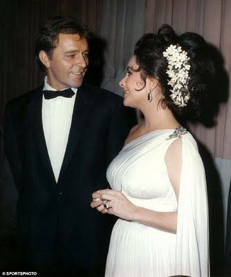 Elizabeth Taylor and Richard Burton . Their second marriage  to one another. 1975-1976