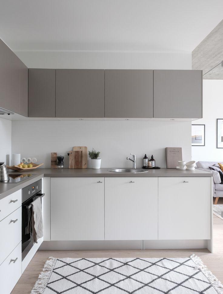 Apartment by Larsen Kinnisvara at Erika 15, Tallinn; styling and photography by Anu Tammiste; Modern Scandinavian white and gray kitchen